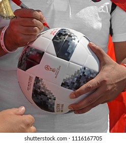 MOSCOW, RUSSIA - JUNE 17, 2018: 2018 FIFA World Cup. Egyptian football player signs ball for fans