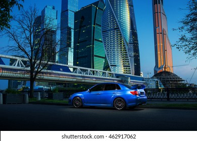 Moscow, Russia - June 18, 2016: Blue car Subaru Impreza WRX STI stay near International Business Center Moscow-City in Moscow at twilight