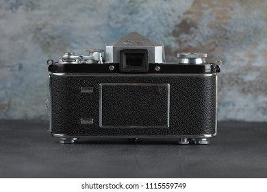 MOSCOW, RUSSIA, JUNE 18, 2018. The old German 35 mm SLR camera Exakta Varex 1950 with lens Victar 1:2,9, released 1950 in in the territory of the former Soviet occupied Germany on a grey cement wall.