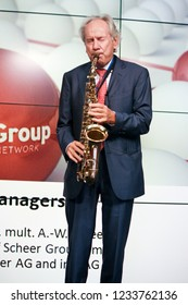 MOSCOW, RUSSIA - JUNE 19, 2012: Head of Scheer Management company August-Wilhelm Scheer play jazz theme the saxophone at Mission Possible conference on June 19, 2012 in Moscow, Russia.