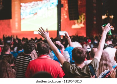 MOSCOW, RUSSIA - JUNE 19, 2018: games of Group A of FIFA 2018 World Football championship. Supporters watch the match Russia VS Egypt in the Fan Festival. Football fans jump, sing and raise hangs up.