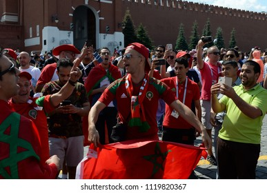 MOSCOW, RUSSIA  JUNE 19, 2018: World Cup 2018, Moroccan football fans with the flag of the country on Red Square. FIFA world cup, Mundial 2018.