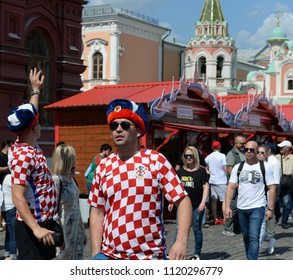 MOSCOW, RUSSIA  JUNE 19, 2018: World Cup 2018,Foreign football fans in Russian souvenir hats on Red Square. FIFA world cup, Mundial 2018.