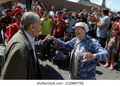 MOSCOW, RUSSIA  JUNE 19, 2018: World Cup 2018, An elderly couple dances on Red Square. FIFA world cup, Mundial 2018.