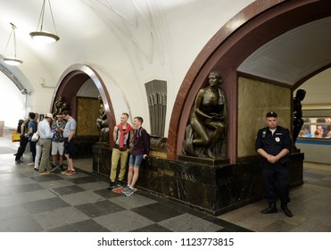 "MOSCOW, RUSSIA  JUNE 19, 2018: A policeman at the metro station ""Ploshchad Revolutsii"" in Moscow."