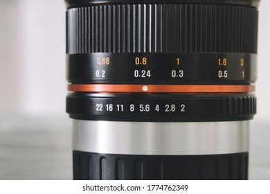 Moscow / Russia - june 1st 2020: the close photo of manual focus SAMYANG lens for mirrorless APSC cameras on white background. Aperture scale and focus distance scale markings on optical lens.