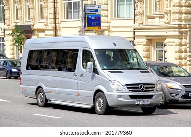 MOSCOW, RUSSIA - JUNE 2, 2013: Silver Mercedes-Benz W906 Sprinter touristic minibus at the city street..