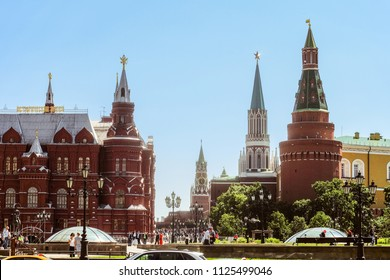 Moscow, Russia - June 2, 2018: Center of the capital of Russia. Nikolskaya, Spasskaya, Corner Arsenalnaya and towers of the historical museum in Moscow Kremlin on Red Square. Okhotny Ryad, Manezhnaya