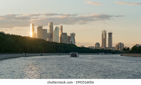 Moscow, Russia - June 2, 2021: Cityscape during summer sunset. Last sun lights. Skyscrapers of the modern Moscow International Business center (MIBC). Wide perspective. Navigationon the Moskva river
