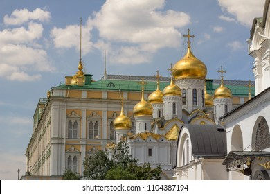 Moscow, Russia - June 20, 2016:   Distinctive architecture of gold-domed Cathedral of the Annunciation and green-roofed Armoury building which houses one of the oldest museums in Moscow
