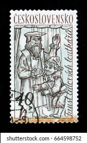 MOSCOW, RUSSIA - JUNE 20, 2017: A stamp printed in Czechoslovakia shows man with puppets, circa 1961