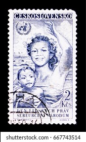 MOSCOW, RUSSIA - JUNE 20, 2017: A stamp printed in Czechoslovakia shows woman with child, Day of human rights, circa 1950