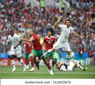 MOSCOW, RUSSIA - June 20, 2018: Mehdi Benatia of Morocco kicks the ball during the World Cup Group B game between Portugal and Morocco at Luzhniki Stadium.