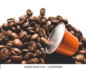 MOSCOW, RUSSIA - JUNE 20, 2018: Nespresso Coffee Capsule  and Coffee Beans Scattered on White Background Texture Top View Copy Space