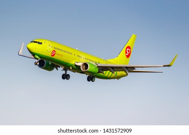 Moscow, Russia - June 20, 2019: Aircraft Boeing 737-8LP(WL) VQ-BRQ of S7 Siberia Airlines landing at Domodedovo international airport in Moscow on a blue sky background at sunny evening
