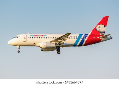 Moscow, Russia - June 20, 2019: Aircraft Sukhoi Superjet 100-95LR RA-89072 of Yamal Airlines landing at Domodedovo international airport in Moscow on a blue sky background at sunny evening