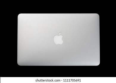 Moscow, Russia - June, 2018: Image of Macbook on black background. Top view. MacBook is a brand of notebook laptop computers manufactured by Apple Inc.