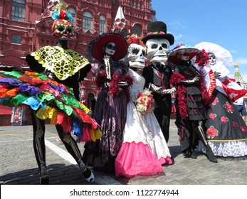 Moscow, Russia - June 2018: People in death masks during the Mexican holiday on Red Square in Moscow. Dia de los Muertos, Day of the Dead