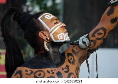 Moscow, Russia - June 2019: Mayan warrior in combat coloring of jaguar on historical festival Times and epochs. Show by the Mexican group Xipetotek, reenactors of authentic Maya culture and history