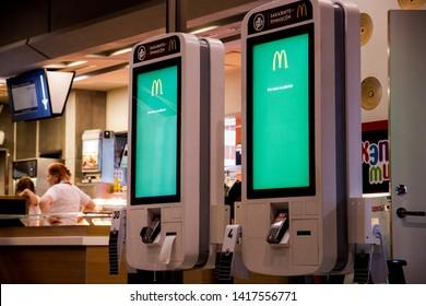 Moscow, Russia - June 2019: McDonald's order kiosk pay through self.  McDonald's restaurant interior.