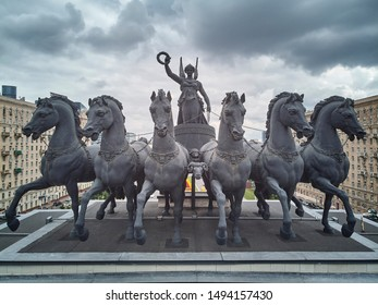 Moscow, Russia - June 2019. Nike Goddess with six horses sculpture on the top of Triumphal arch on Kutuzovskiy avenue. Aerial view