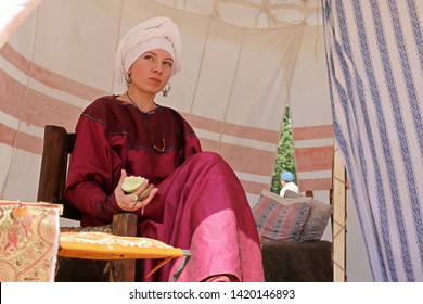 Moscow, Russia - June 2019: Noble woman in Byzantine clothes sitting in a tent during the Moscow historical festival Times and Epochs. Reconstruction of life in the Byzantine Empire