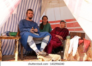Moscow, Russia - June 2019: People in Byzantine clothes of 10th century in a patrician tent during the Moscow historical festival Times and epochs. Reconstruction of life in the Byzantine Empire