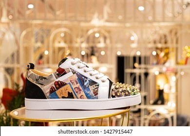 Moscow, Russia - June 2019: Showcase At Louboutin Store, Shoes Or Sneakers (Vieira Spikes Orlato). Exhibition Composition New Collection Pre-Fall 2019 In Luxury Boutique In Christian Louboutin.