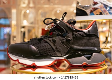 Moscow, Russia - June 2019: Showcase At Louboutin Store, Black Men Sneakers (Red-runner Men). Exhibition Composition New Collection Pre-Fall 2019 In Luxury Boutique In Louboutin.