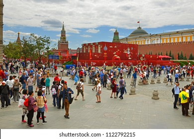MOSCOW, RUSSIA - JUNE 21, 2018: Fans and tourists in background of 2018 FIFA World Cup Russia Football Park on Red Square in Moscow