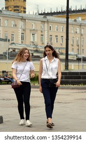 MOSCOW, RUSSIA - JUNE 21, 2018: Unknown girls walking on Gogol Boulevard in Moscow
