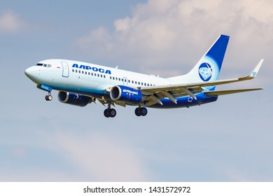 Moscow, Russia - June 21, 2019: Aircraft Boeing 737-7CT(WL) EI-GFR of Alrosa Avia airline landing at Domodedovo international airport in Moscow on a cloudy blue sky background at sunny day
