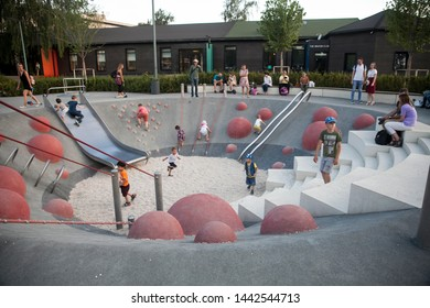 Moscow, Russia - June 22, 2019: Gorky Park. Childrens and their parents on the modern childrens playground in the Gorky Park.