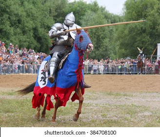 "MOSCOW, RUSSIA - JUNE 23, 2013: Medieval knight on a horse at the tournament, festival ""Times and ages"", Kolomenskoe Park, Moscow"
