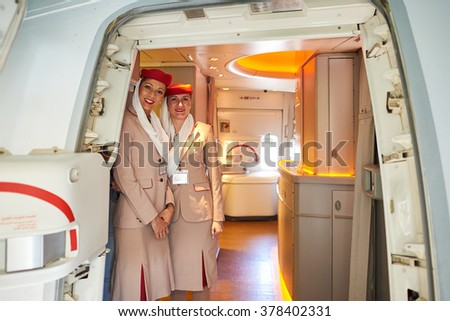 MOSCOW, RUSSIA - JUNE 23, 2015: Emirates crew members stand near door of Boeing-777. Emirates is one of two flag carriers of the United Arab Emirates along with Etihad Airways and is based in Dubai.