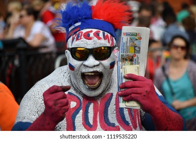 Moscow, Russia - June 23, 2018: World Cup 2018, Russian football fans on the streets of Moscow. Soccer fans from abroad walking down the streets of Moscow, FIFA world cup, Mundial 2018