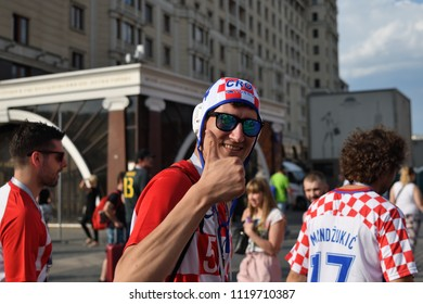 Moscow, Russia - June 23, 2018. World Cup 2018, Croatian football fans walking down on the streets in Moscow. FIFA world cup, Mundial 2018