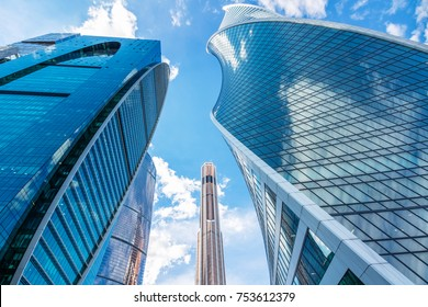 Moscow, Russia - June 24, 2017: Towers of skyscrapers of Moscow-city with a view from below on a background of cloudy summer sky