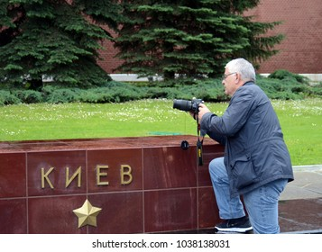 MOSCOW, RUSSIA - JUNE 25, 2017: A photographer on the alley of hero cities at the Tomb of the Unknown Soldier in the Alexander Garden of the Moscow Kremlin.