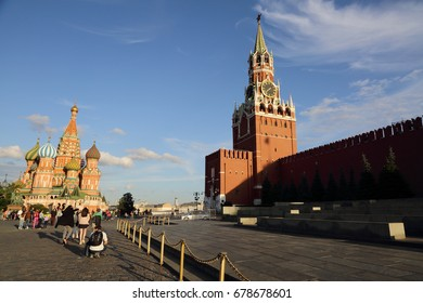 MOSCOW, RUSSIA - JUNE 25, 2017: People are walking over Spasskaya tower of the Moscow Kremlin. The symbol of the Russian Federation. The main square of Moscow.