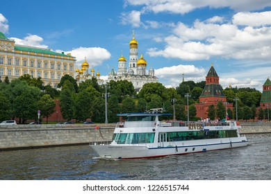 MOSCOW, RUSSIA - JUNE 25, 2018: View of the river Moscow with walking ship, Kremlevskaya Embankment and towers of the Kremlin