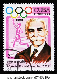 MOSCOW, RUSSIA - JUNE 26, 2017: A stamp printed in Cuba shows Baron de Coubertin, torchbearer, international Olympic committee, 90th anniversary, circa 1984