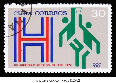 "MOSCOW, RUSSIA - JUNE 26, 2017: A stamp printed in Cuba with a picture of a basketball players, from the series ""XX Summer Olympic Games, Munich, 1972"", circa 1973"