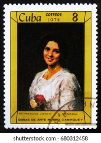 """MOSCOW, RUSSIA - JUNE 26, 2017: A stamp printed in Cuba shows a painting """"Portrait of a Young Woman"""" by A. Menocal, the series Paintings in Camaguey Museum, circa 1974"""