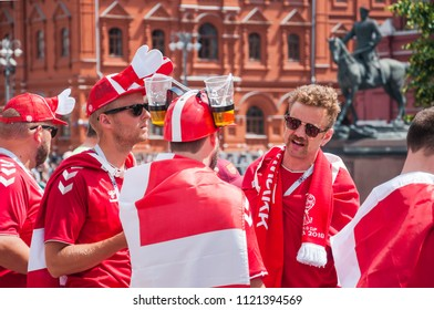 MOSCOW, RUSSIA - June 26, 2018: The 2018 FIFA World Cup. Danish fans in red t-shirts drink beer on Manezhnaya square