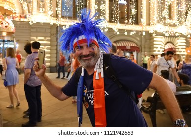 Moscow, Russia - June 26, 2018: French football fans on the night streets of Moscow. Soccer fans from abroad walking down the Nikolskaya streets in Moscow, FIFA world cup, Mundial 2018