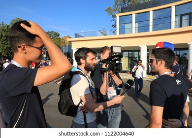 MOSCOW, RUSSIA - June 26, 2018: television interviews from French fans after the World Cup Group C game between France and Denmark at Luzhniki Stadium