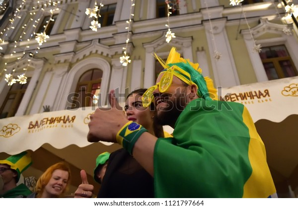Moscow, Russia - June 26, 2018: Brazilian football fan on the night streets of Moscow. Soccer fans from abroad walking down the Nikolskaya streets in Moscow, FIFA world cup, Mundial 2018
