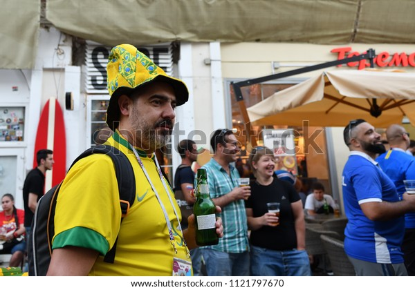 Moscow, Russia - June 26, 2018: Brazilian football fan on the streets of Moscow. Soccer fans from abroad walking down the Nikolskaya streets in Moscow, FIFA world cup, Mundial 2018