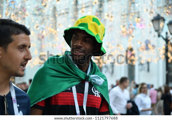 Moscow, Russia - June 26, 2018: Brazilian football fans on the streets of Moscow. Soccer fans from abroad walking down the Nikolskaya streets in Moscow, FIFA world cup, Mundial 2018